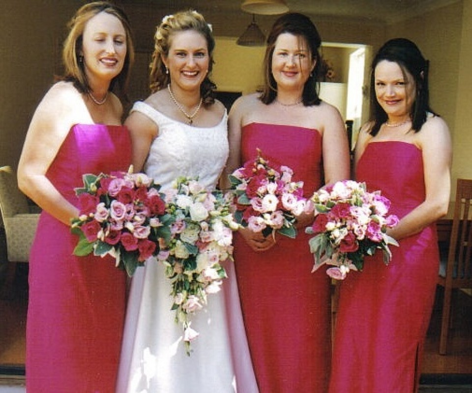 White and hot pink bouquets to complement bridal colour scheme