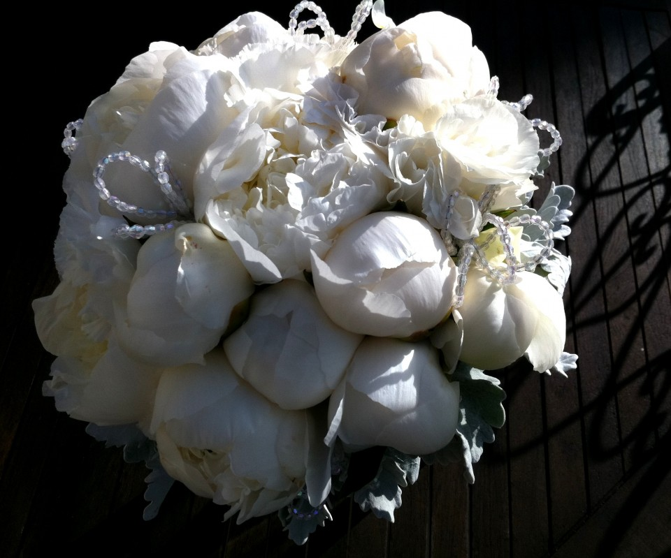 White closed peonies and crystal bouquet