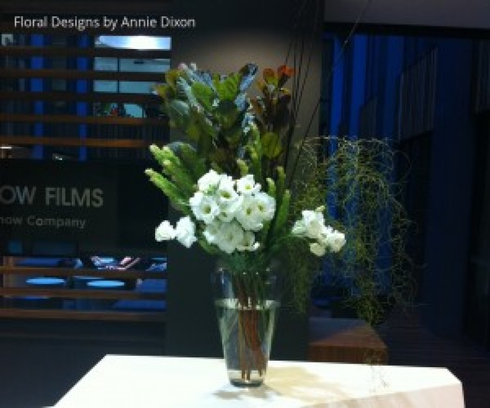 Vase of Lisianthas and foliage on reception