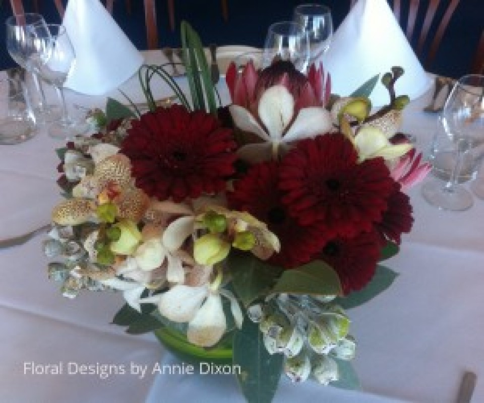 Corporate lunch burgundy table arrangement