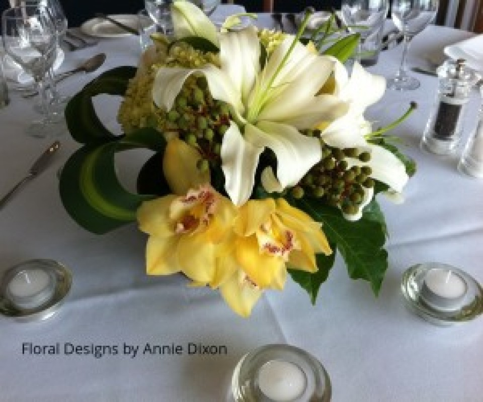 Corporate dinner - yellow and white table arrangement