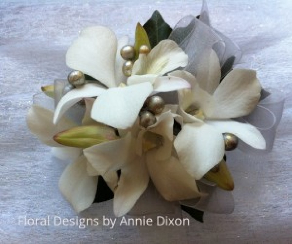 Laura Orchid and silver corsage