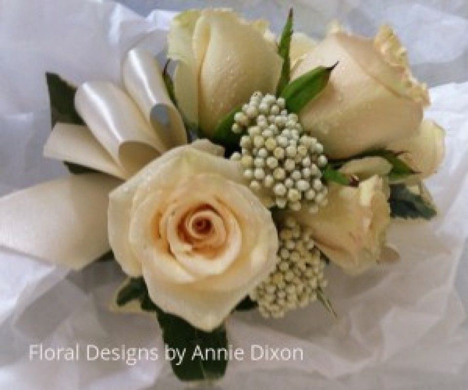 Cream mini rose and riceflower corsage
