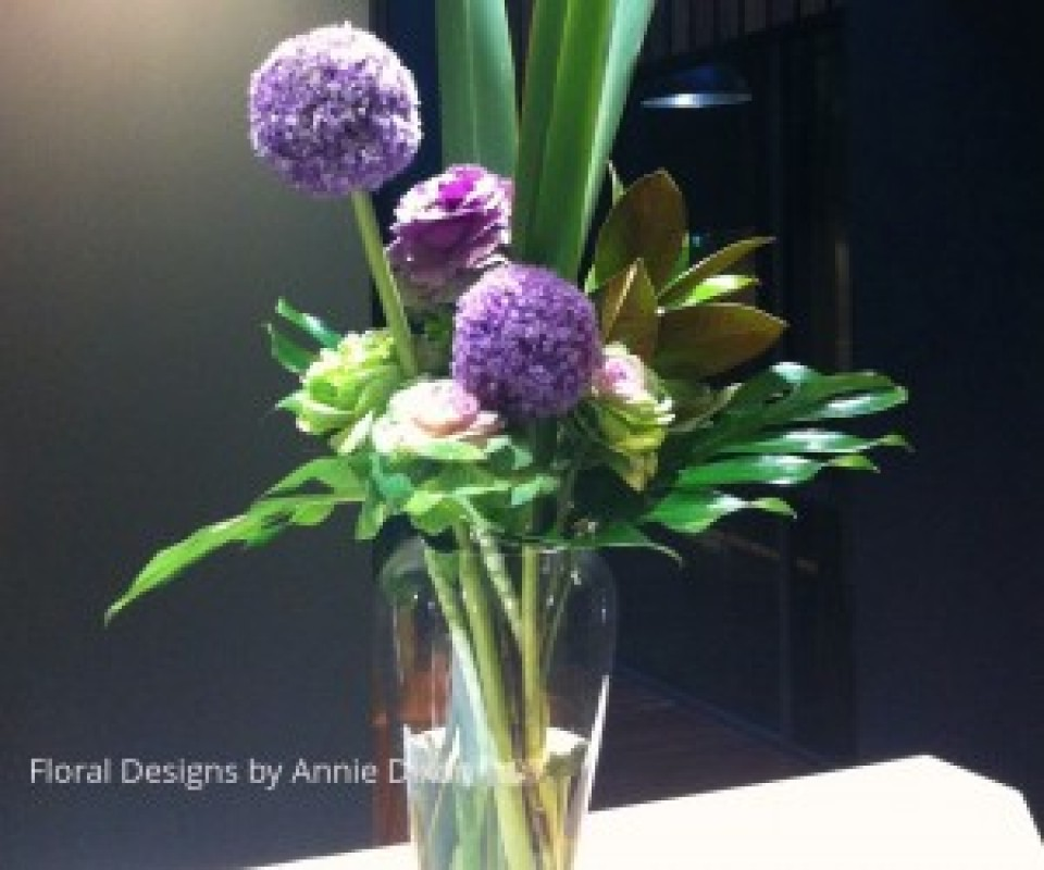 Contemporary arrangement of Alliums and Kale on bar
