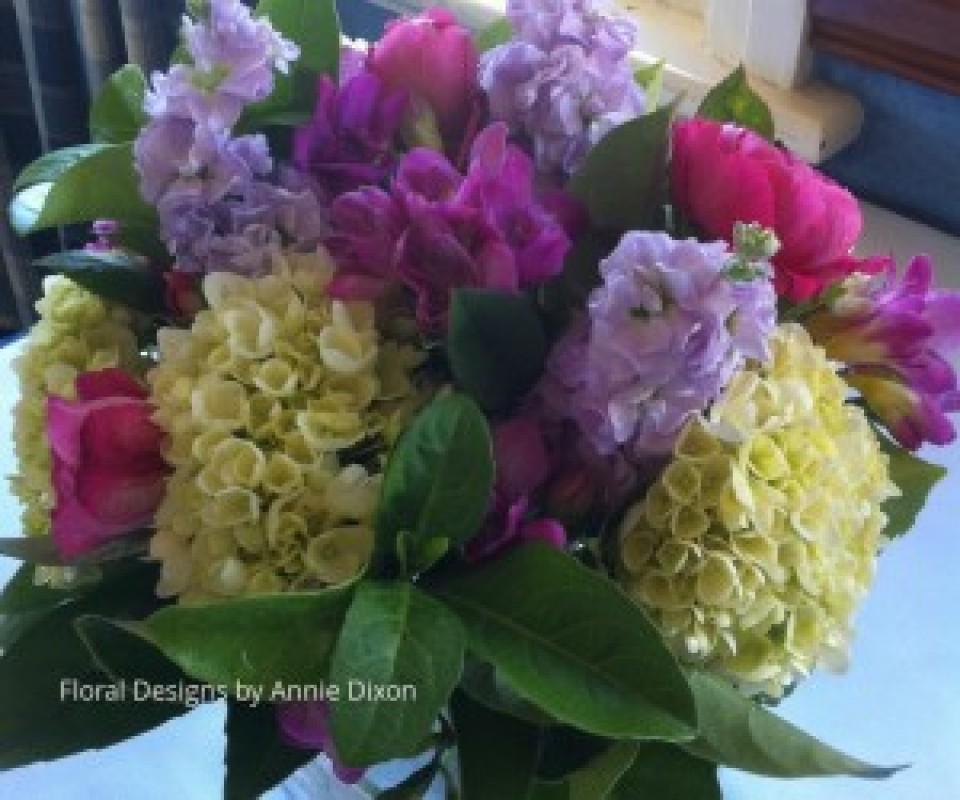 Bedside table arrangement of perfumed Spring flowers