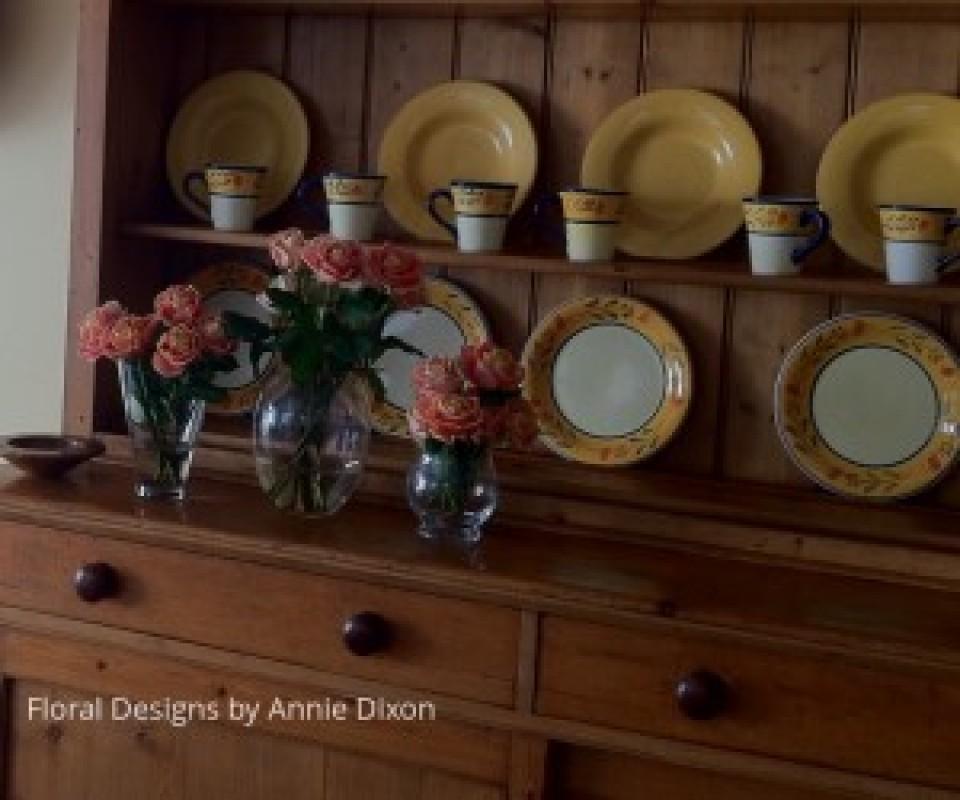 Display of roses on kitchen dresser