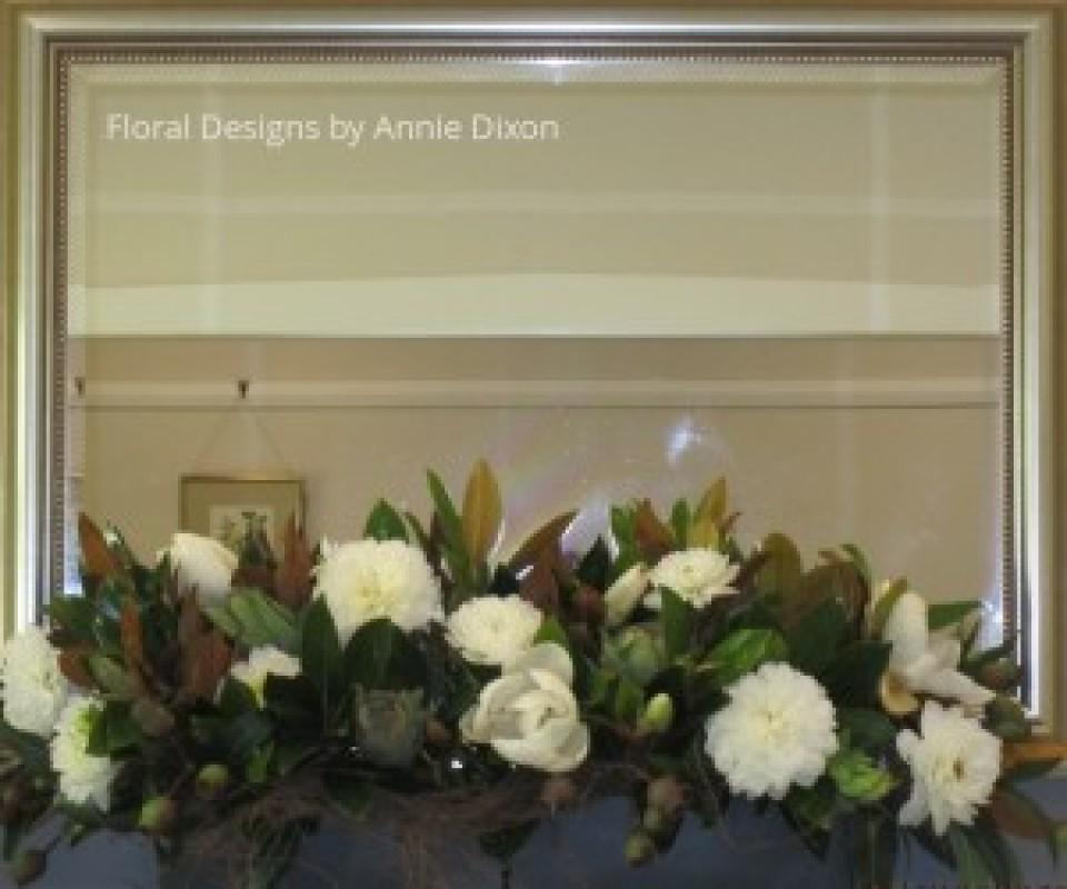 Close up of magnolia arrangement over mantle