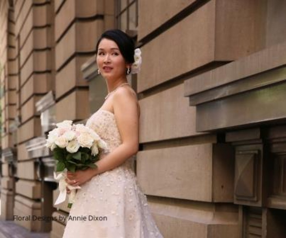 Bride holding her natural stem bouquet of roses