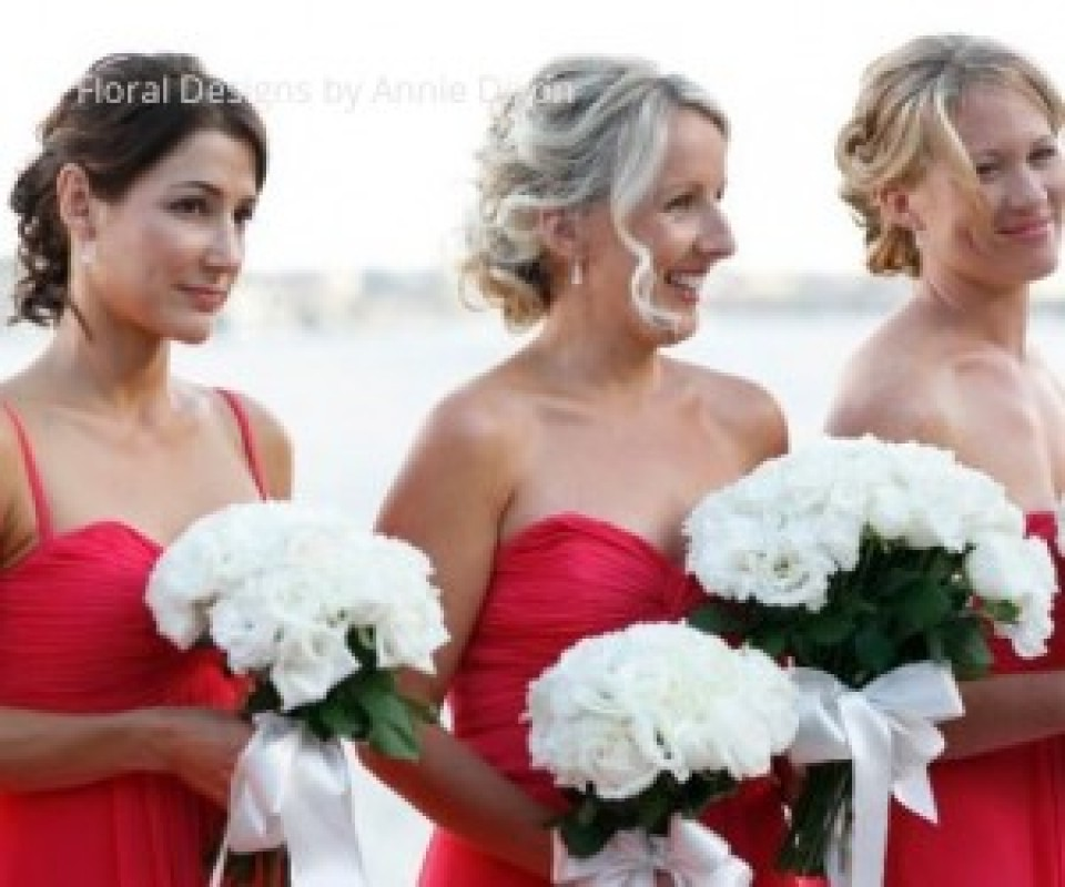 Bridesmaids' Posies of ivory roses and lisianthus