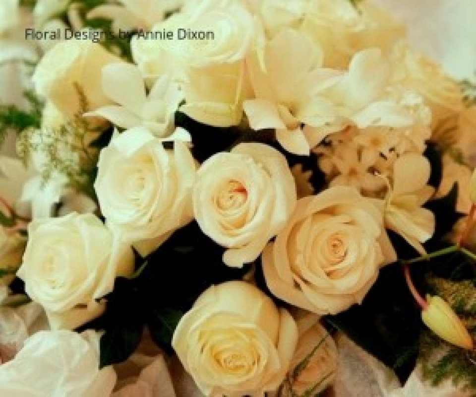 Cream bridal bouquet of roses, Laura orchids and hyacinths