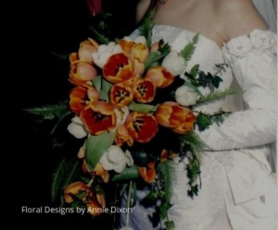 Trailing bridal bouquet of orange tulips