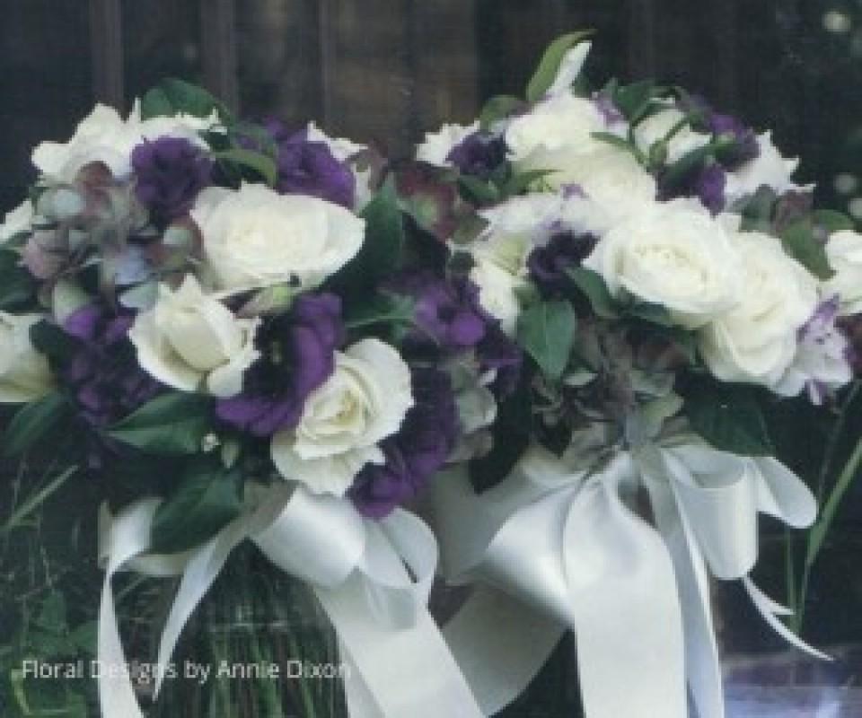 Bridemaids' posies of purple lisianthus, ivory roses and autumn hydrangea
