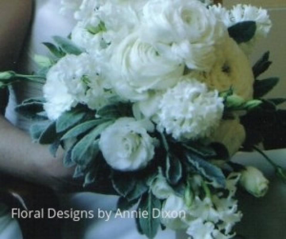 Teardrop bridal bouquet of ranunculus, hyacinths and lissianthas