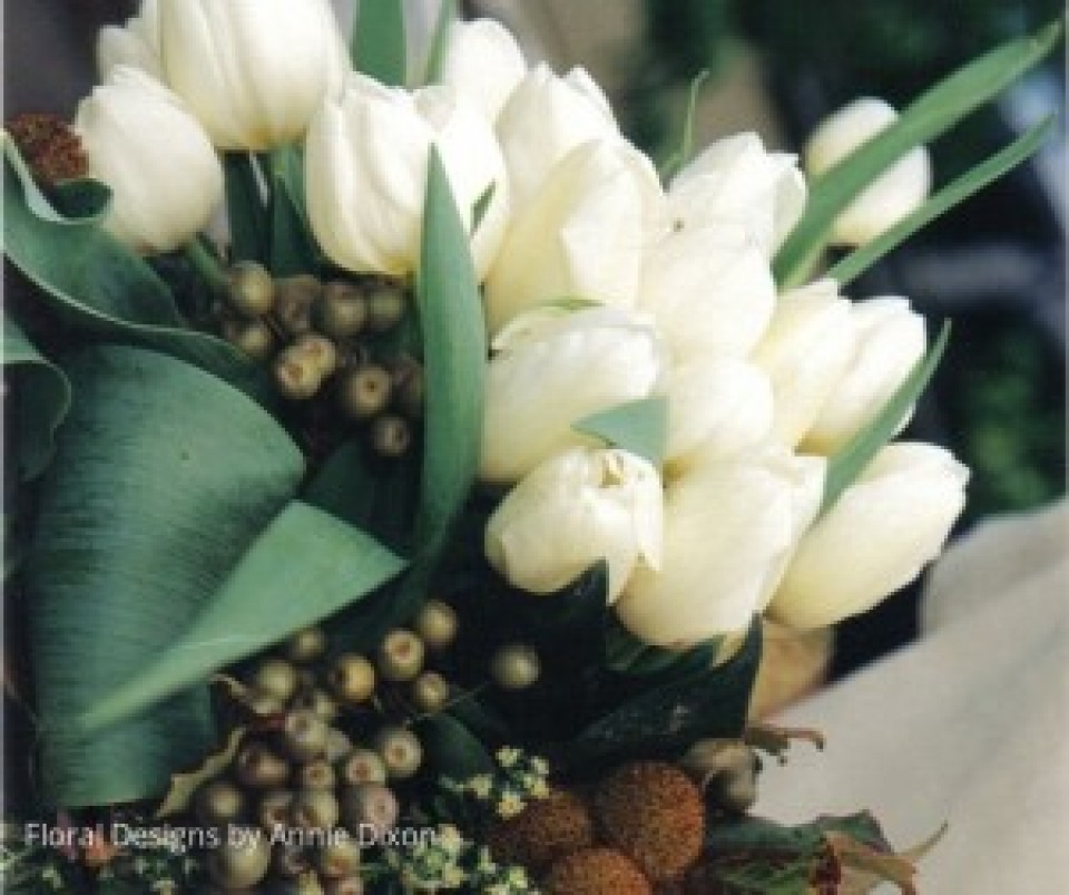 Autumnal bridal bouquet of white tulips