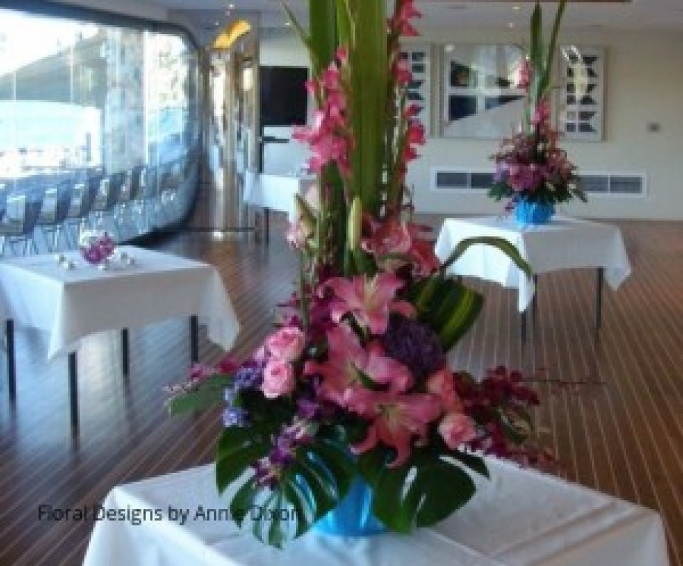 Two pink centrepiece arrangements of Gladioli, Oriental Lilies, Hydrangea, Roses and Orchids