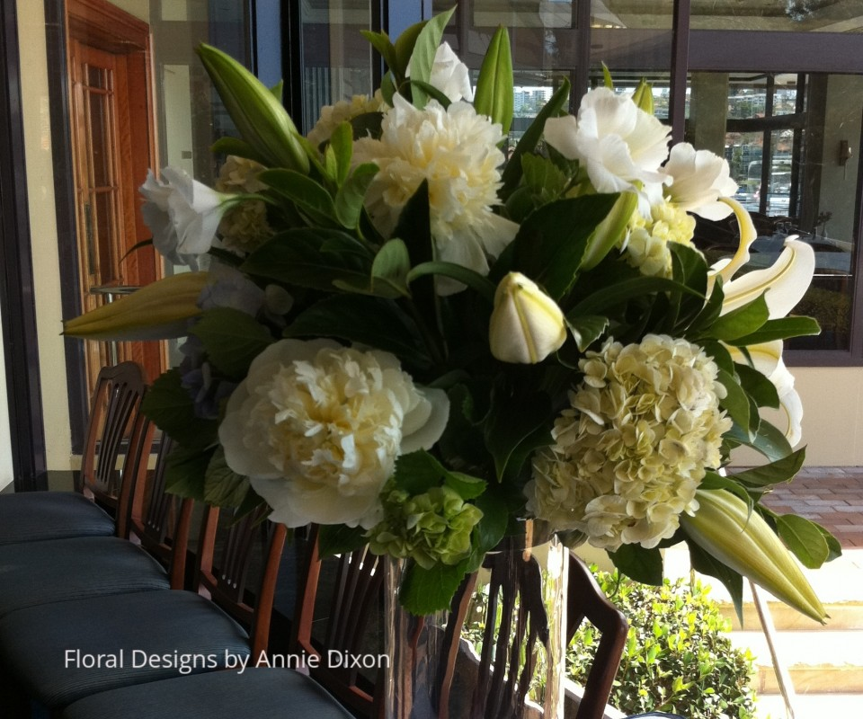 Cylinder arrangement of peonies, hydrangea, lilies and lissianthas