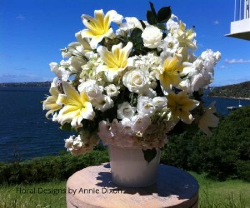 Large arrangement of lemon and white flowers for outdoor wedding ceremony overlooking Chowder Bay