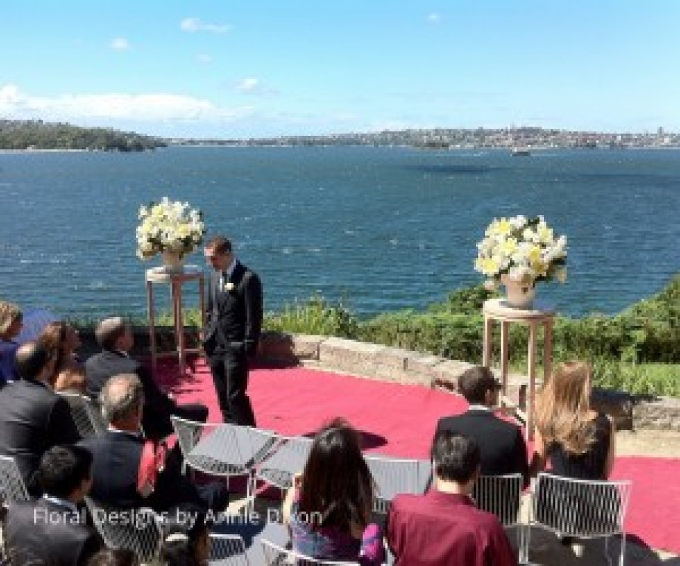 Two pedestal arrangements for outdoor wedding ceremony at Sergeants Mess