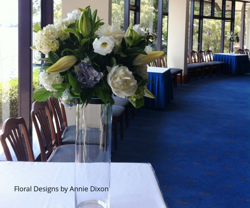 Blue and white glass cylinder arrangements in bay windows