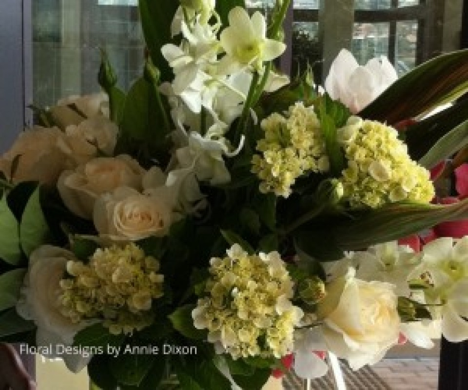 Ivory and cream display of Hydrangea, Orchids and Roses