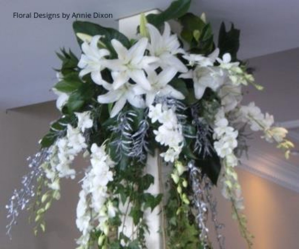 Close up of large silver and white arrangement cascading from ceiling