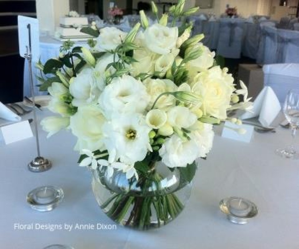 Classic arrangemnt of cream roses, ivory lisianthus, freesias and bouvardia