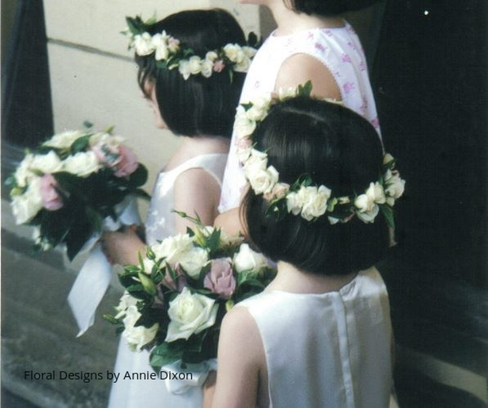 Flowergirls adorned with hair galands and matching posies