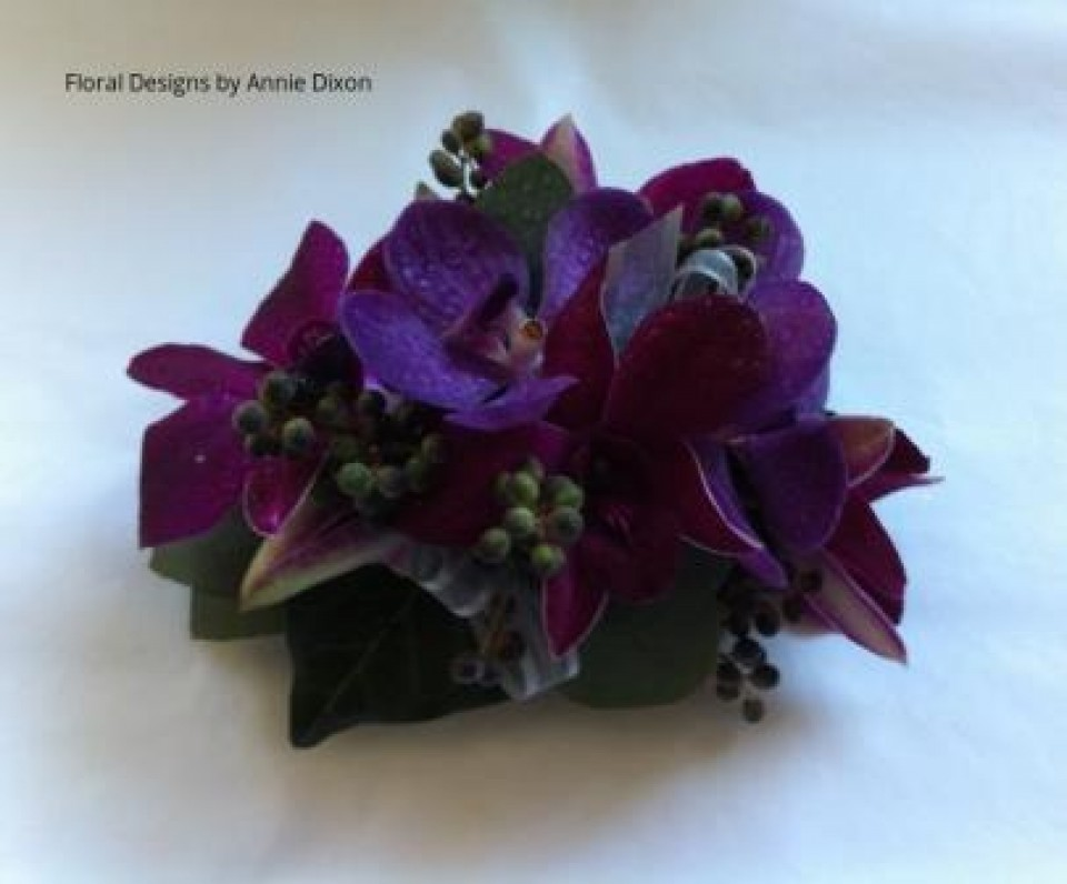 Purple orchid corsage with autumn berries