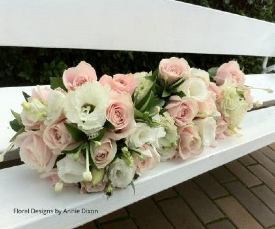 Posies of Sweet Avalanche roses, lisianthus and bouvardia on garden bench