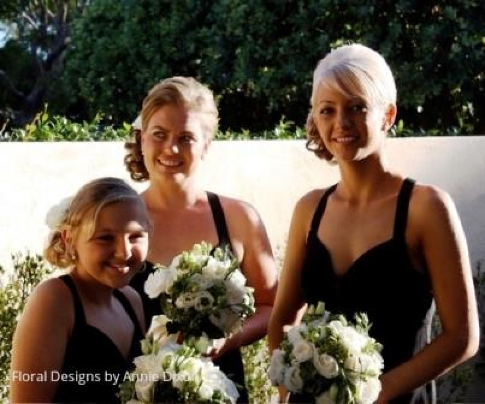 3 bridesmaids with posies of green hydrangea and white lisianthus