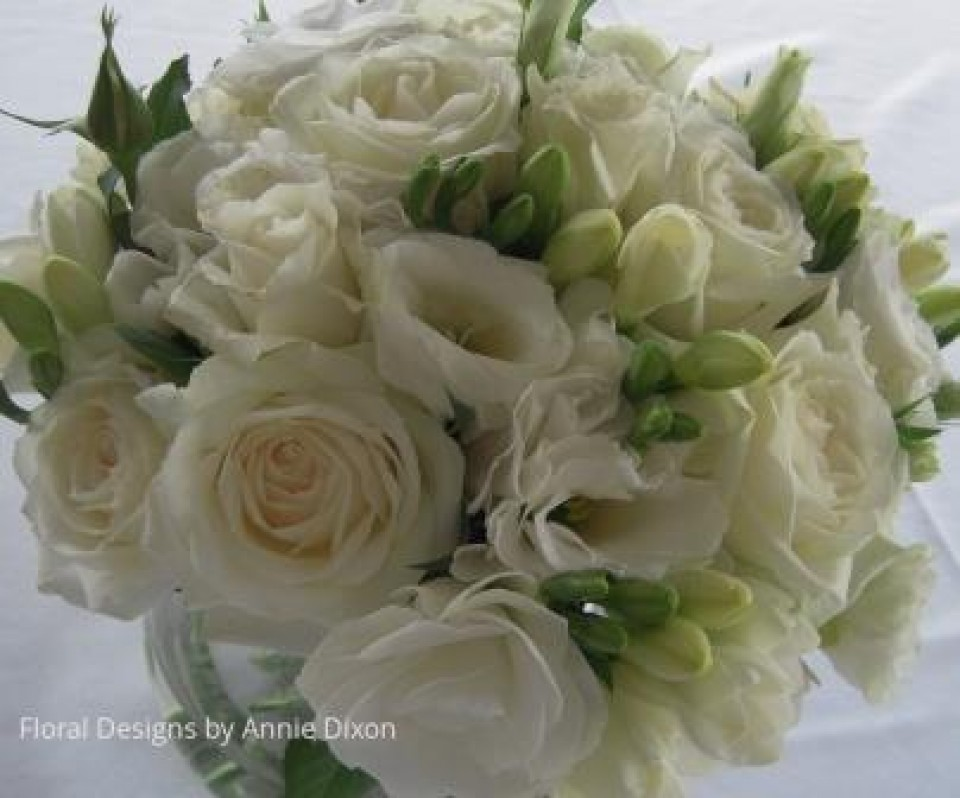 Ivory bouquet of freesias, roses and lisianthus