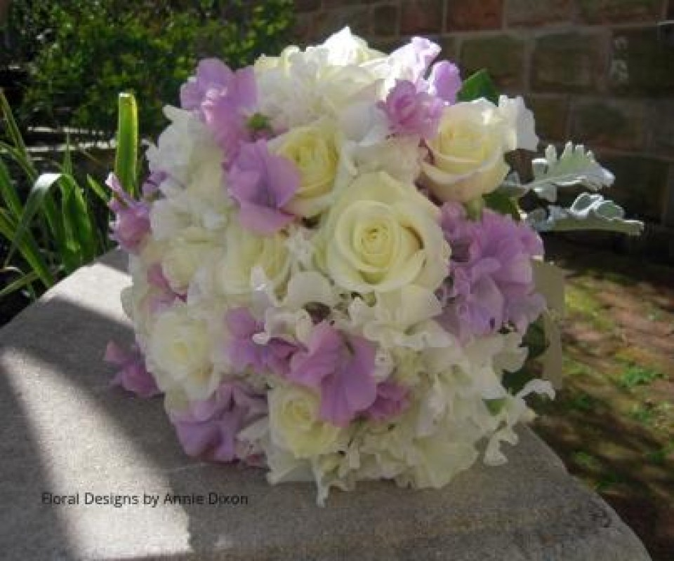 Posy of lilac sweet peas and roses